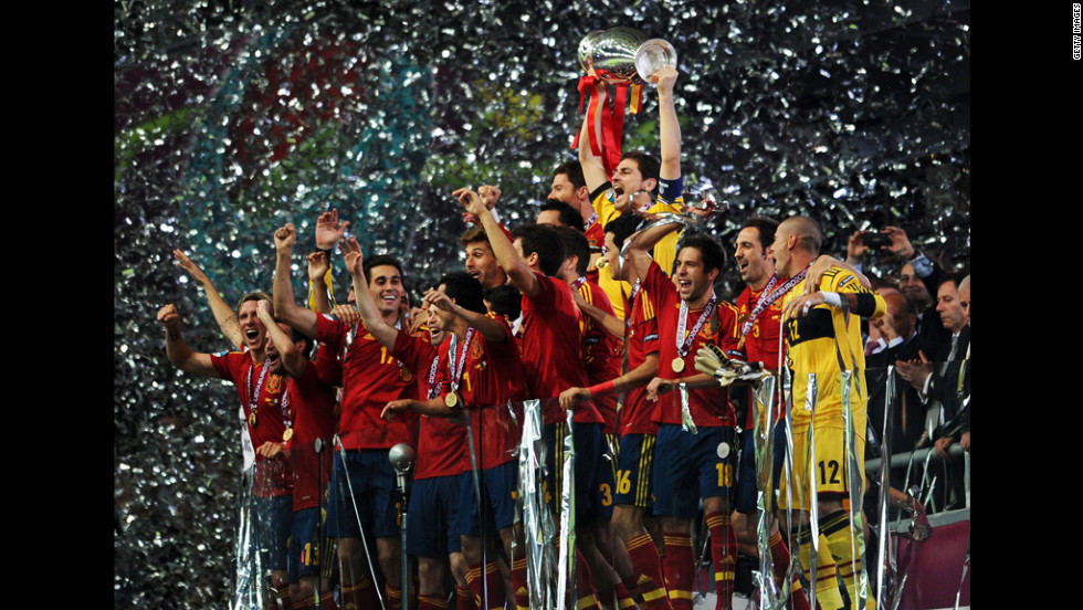 Captain Iker Casillas of Spain lifts the trophy after the team defeated Italy 4-0 in the Euro 2012 final on Sunday, July 1, in Kiev, Ukraine.