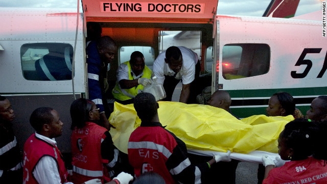 A victim of one of the attacks on churches in the Kenyan town of Garissa, near the border with Somalia, is wheeled by paramedics on July 1, 2012 to a waiting ambulance after she was airlifted to Nairobi.