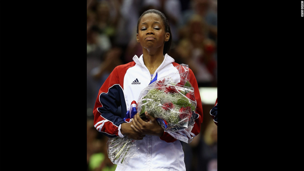Gabrielle Douglas reacts after being named to the U.S. gymnastics team going to the 2012 London Olympics.