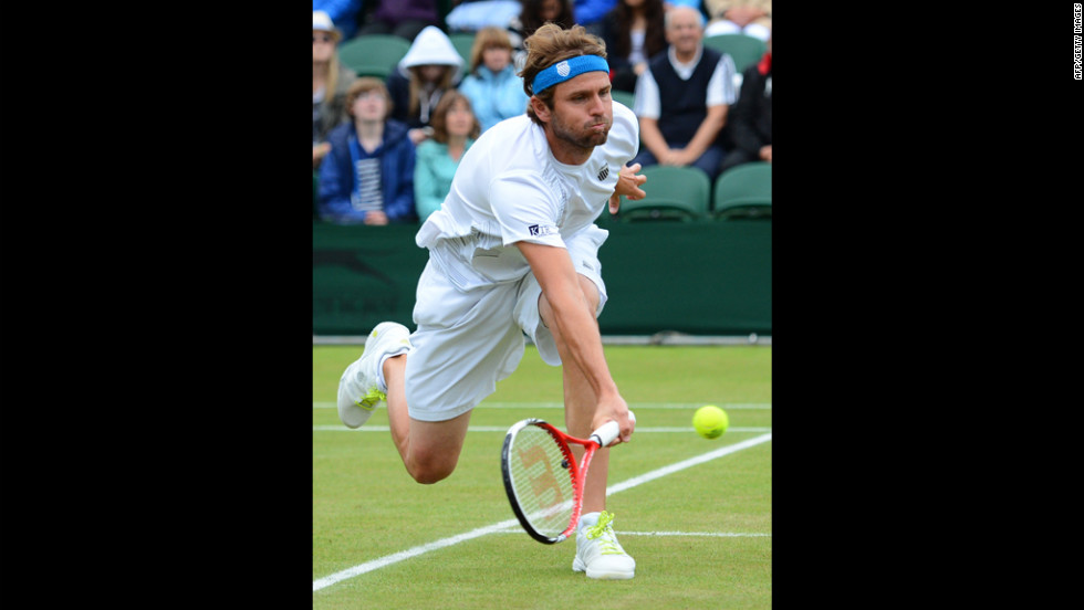 Mardy Fish of USA plays a forehand shot against Jo-Wilfried Tsonga on Monday.