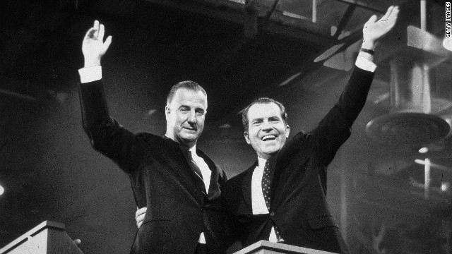 Republican presidential candidate Richard M. Nixon (R) and his running mate Spiro Agnew wave to crowds during the campaign, circa 1968.