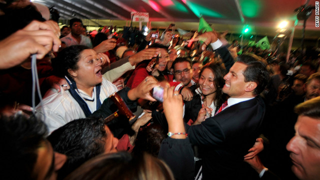 MEXICO CITY, MX - JULY 2: Presidential candidate Enrique Pena Nieto of the Institutional Revolutionary Party (PRI) celebrates with supporters on July 2, 2012 in Mexico City, Mexico. Results of an official preliminary count indicate that Mexico's presidential election front-runner Enrique Pena Nieto holds a substantial lead over Andres Manuel Lopez Obrador.  (Photo by Daniel Aguilar/Getty Images)
