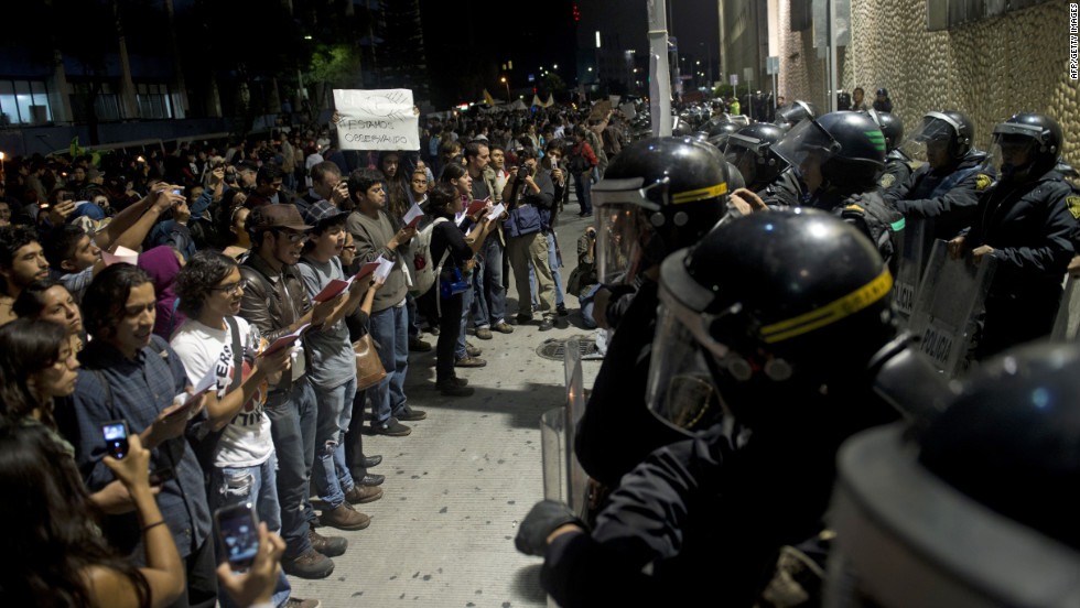 "Protesters supporting the ""I Am 132"" movement rally outside Televisa headquarters in Mexico City on Saturday."
