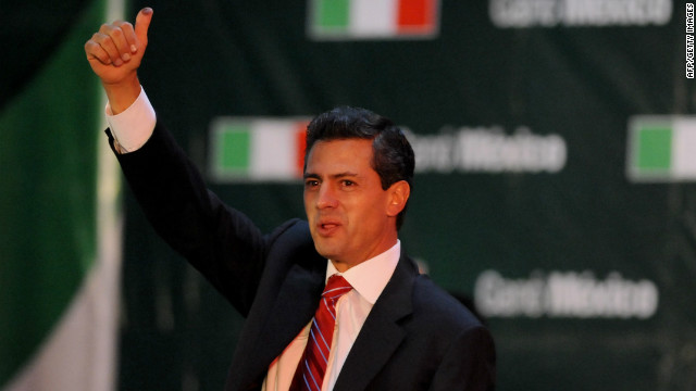 The presidential candidate for the Institutional Revolutionary Party (PRI), Enrique Pe�a Nieto, celebrates after learning the first official results of the presidential election, at the party's headquarters in Mexico City on July 1, 2012.