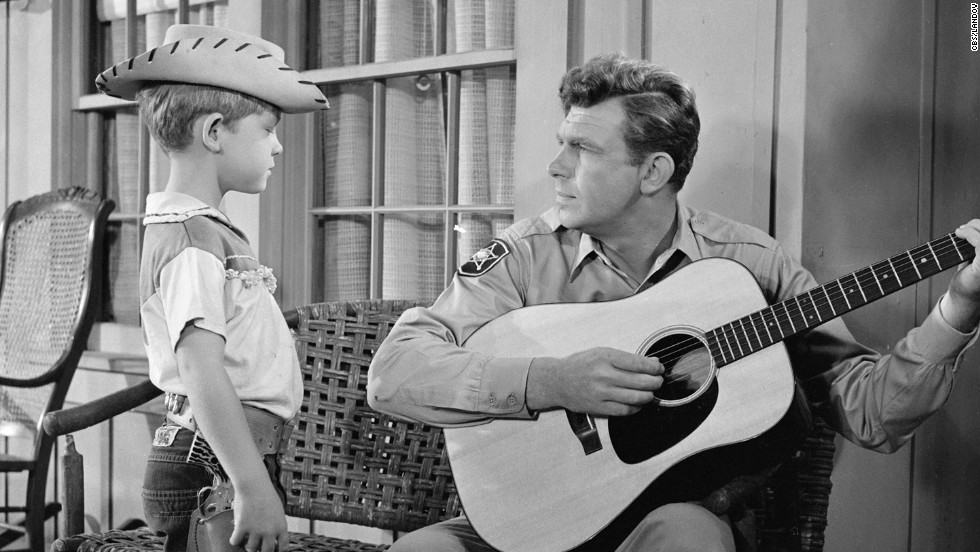 "Griffith plays the guitar for his television son, Opie, during ""The Runaway Kid."""