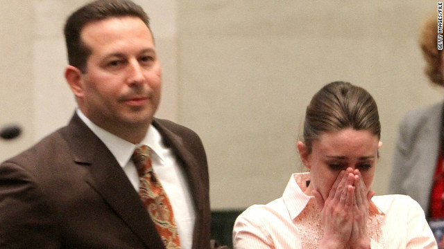 Casey Anthony reacts to being found not guilty on murder charges as she stands next to her attorney Jose Baez at the Orange County Courthouse on July 5, 2011 in Orlando, Florida.