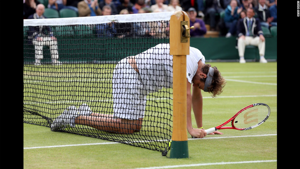 Fish falls to the ground during his fourth round match against Tsonga.