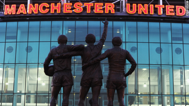 A statue of George Best, Denis Law and Bobby Charlton standing outside Old Trafford, home of Manchester United.