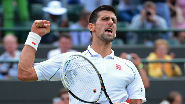 Novak Djokovic celebrates his quarterfinal victory over Florian Mayer at Wimbledon.