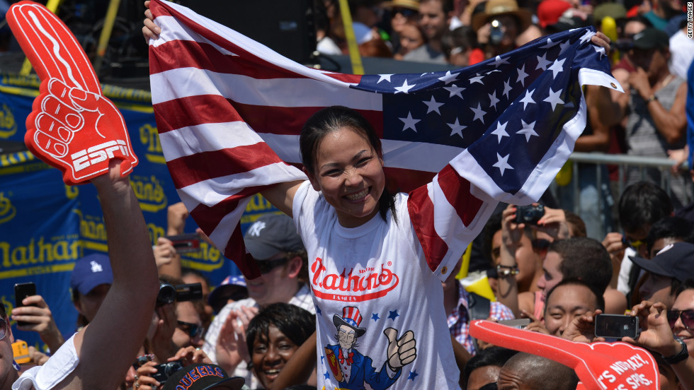 "Sonya ""The Black Widow"" Thomas celebrates her win Wednesday, July 4, at Nathan's annual hot dog-eating competition in Brooklyn, New York."
