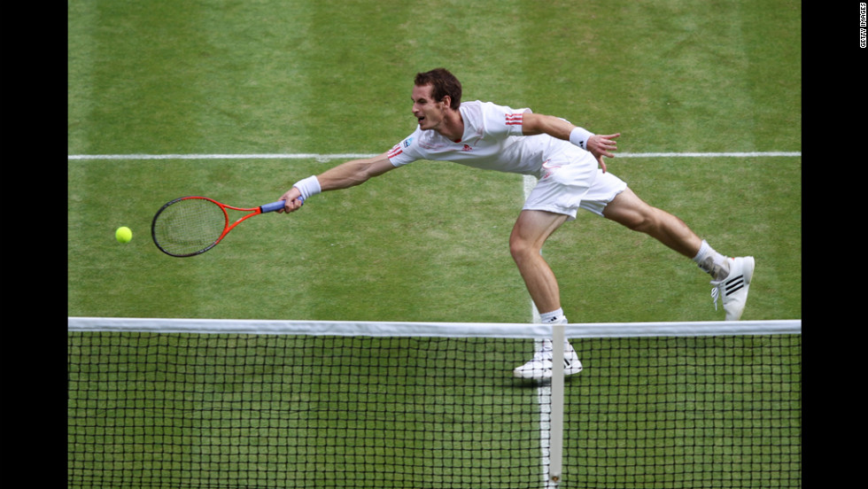 Murray hits during his quarter final match against Ferrer.
