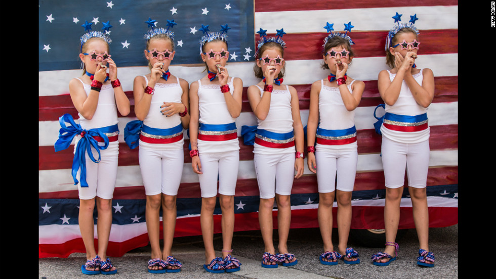 Young members of Uncle Sam's Band play kazoos during the annual Independence Day parade in Mount Pleasant, South Carolina.