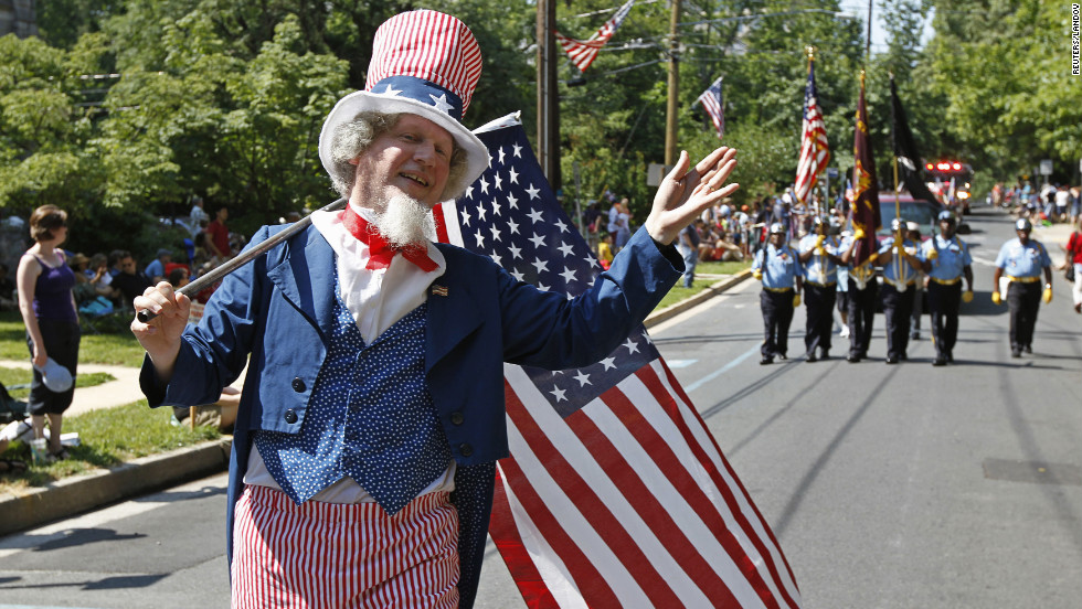 Dressed as Uncle Sam, Jeffrey Silverstone marches in a parade in Takoma Park, Maryland. Parts of the city, a suburb of Washington, D.C., were still without power Wednesday after a massive storm late last week.