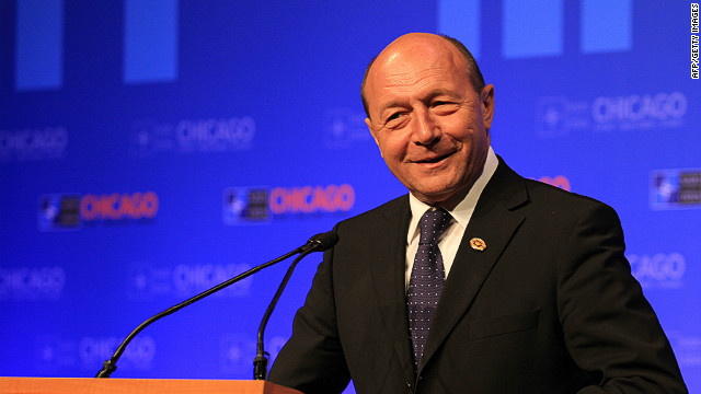 Romania's ruling coalition accused President Traian Basescu of violating the country's constitution.