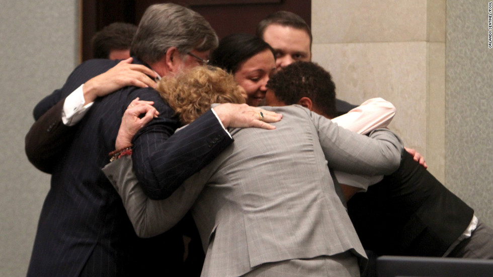 Casey Anthony's defense team surrounds her in a group hug after the then-25-year-old was acquitted.