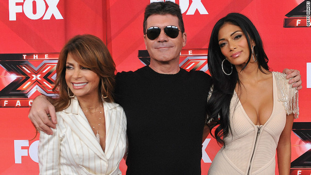 Judges on U.S. TV show the X-Factor: (L-R) Paula Abdul, Simon Cowell and Nicole Scherzinger.