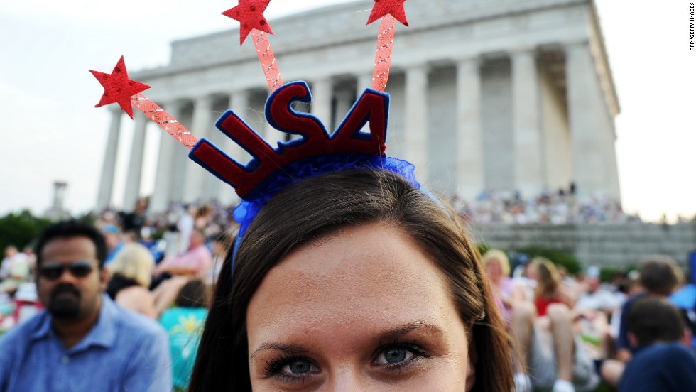 People gather in front the Lincoln Memorial ahead of a fireworks celebration in Washington.
