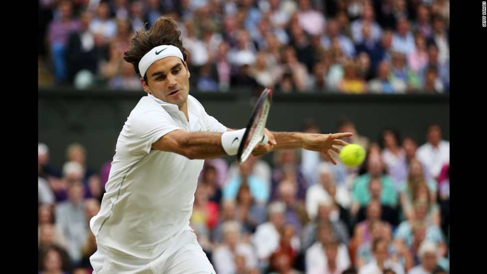 Roger Federer hits a forehand return during his Gentlemen's Singles semifinal match against Novak Djokovic on Friday.