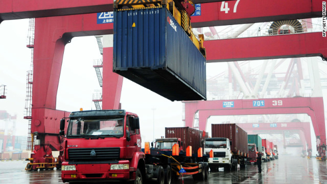 Containers been loaded on to a ship at the Qingdao port, in northeastern China's Shandong province on March 9, 2012. China swung into a huge trade deficit of 31.48 billion USD in February 2012 as oil imports rocketed, customs data showed on March 10, 2012.