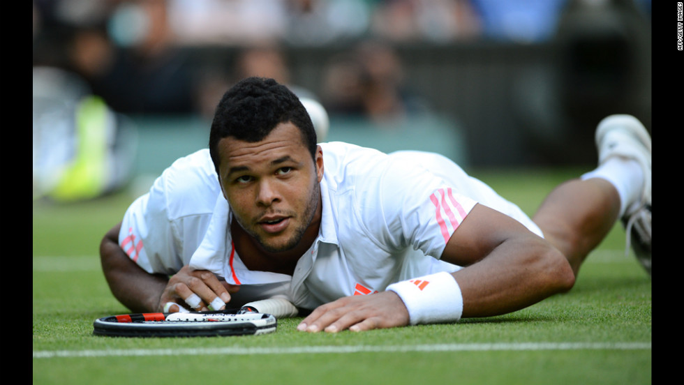 Tsonga looks up after spilling to the grass chasing a shot against Murray.