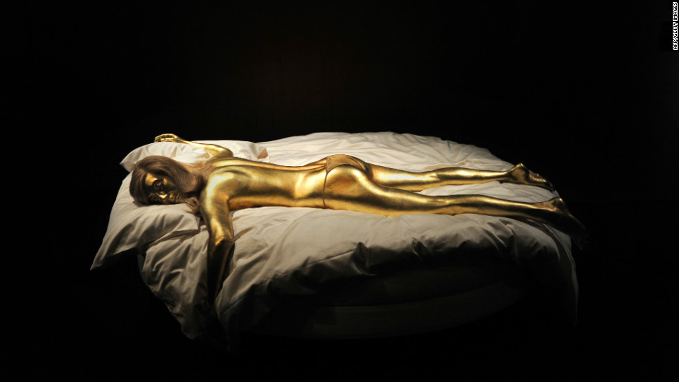 "A replica of the character Jill Masterson, suffocated when she was painted with gold in ""Goldfinger,""  is a centerpiece of the newly-opened James Bond exhibition in London."