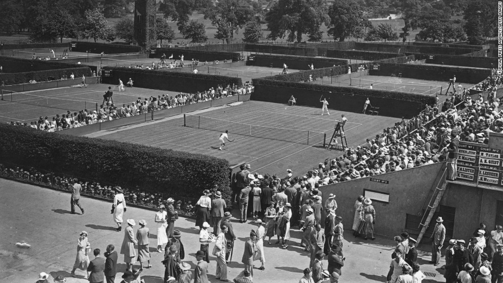 "Crowds watch the tournament on the first day of the matches on June 22, 1936. <a href=""http://www.cnn.com/2012/06/26/tennis/gallery/wimbledon-best-photos/index.html"">See the best photos from this year's Wimbledon competition.</a>"