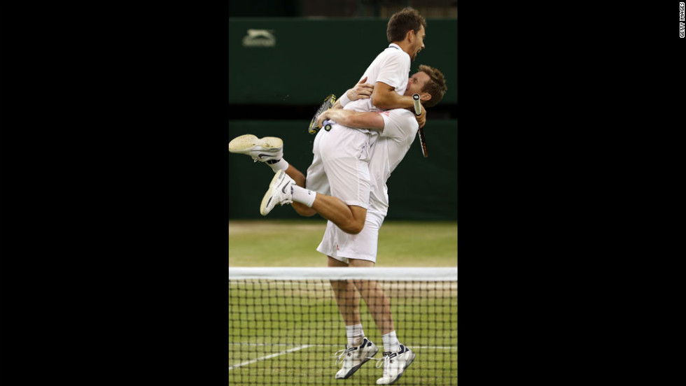 Britain's Jonathan Marray and Denmark's Frederik Nielsen celebrate championship point during the men's doubles final. Marray is the first Briton since 1936 to win a men's doubles title at Wimbledon since 1936.