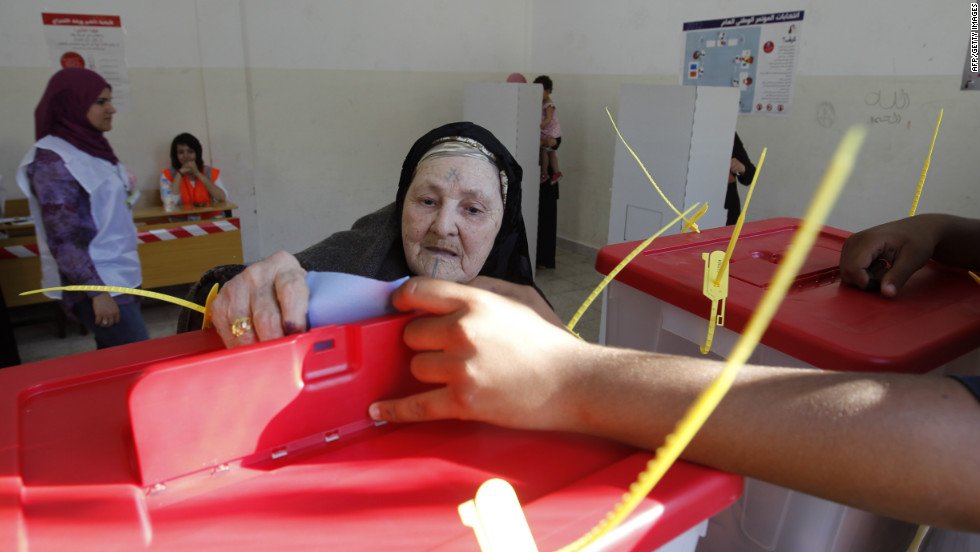 A Libyan woman casts her ballot at a Benghazi polling station.