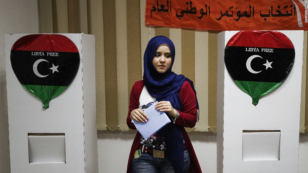 July: A  woman prepares to cast her ballot at a Tripoli polling station during Libya's General National Assembly election on July 7. The last time Libya held an election was almost half a century ago and for many people, the act of casting a ballot was novel after 42 years of Moammar Gadhafi's autocratic rule.