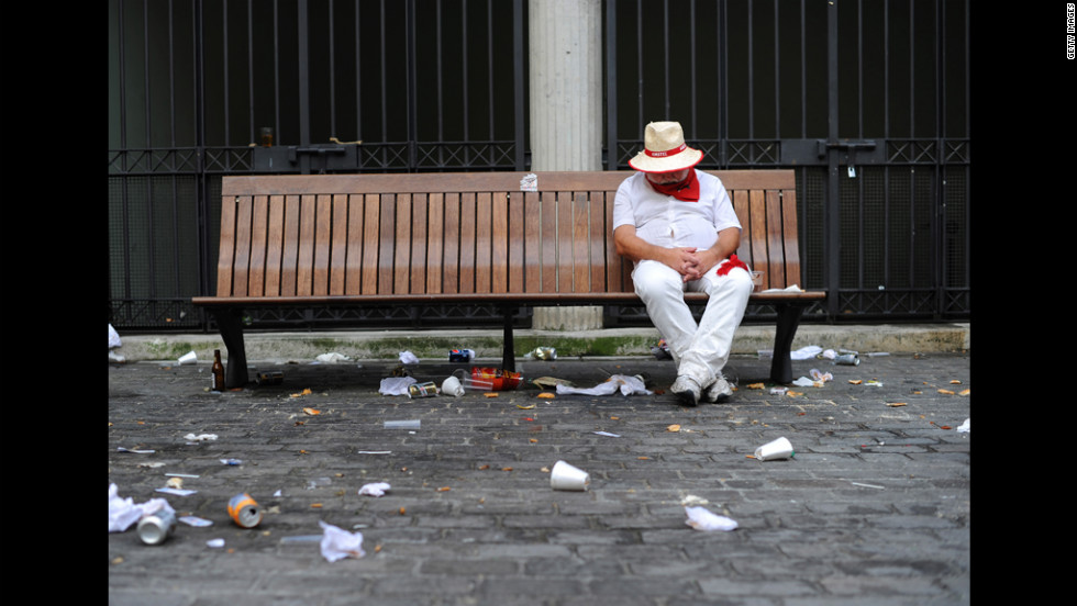 A runner rests on a bench on the first day of the festival.