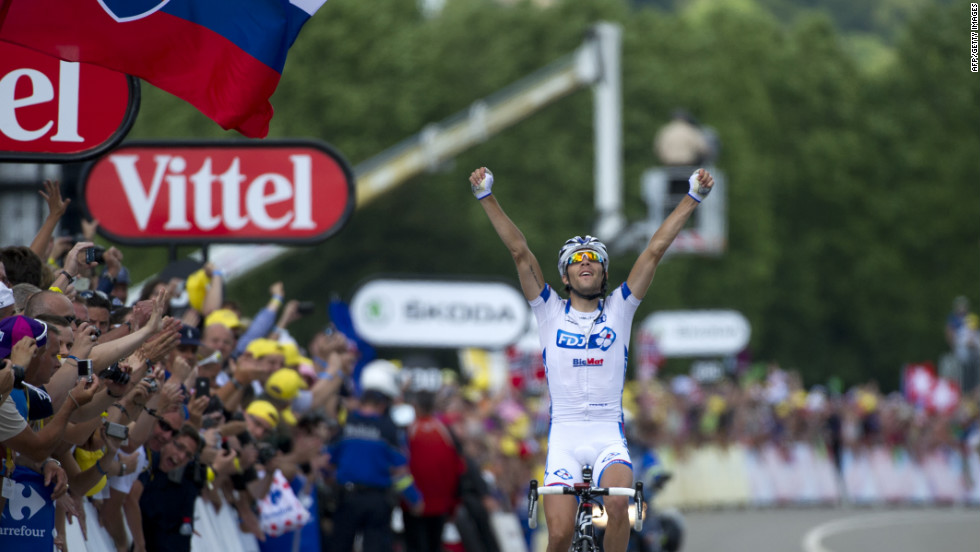 Thibaut Pinot of France celebrates on the finish line after winning Stage 8 of the Tour de France on Sunday, July 8. The stage covered 157.5 kilometers (98 miles) from Belfort, France, to Porrentruy, Switzerland, with seven major climbs.