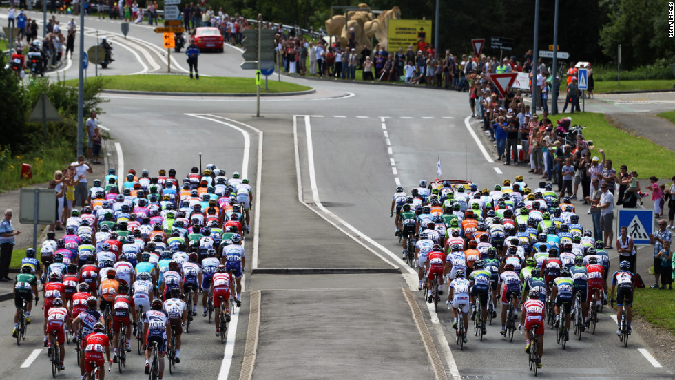 The main group, known as the peloton, departs from Belfort at the start of the race Sunday.