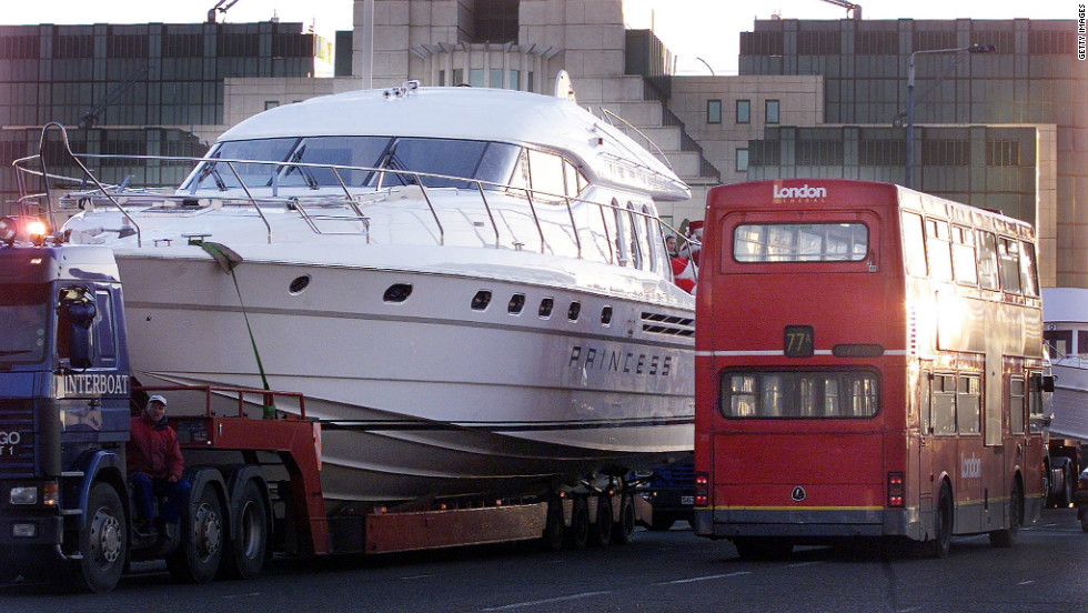 A superyacht dwarfs a London double-decker bus. The luxury boats, usually over 25 meters long, have earned a reputation as the toy of choice for the rich and famous.