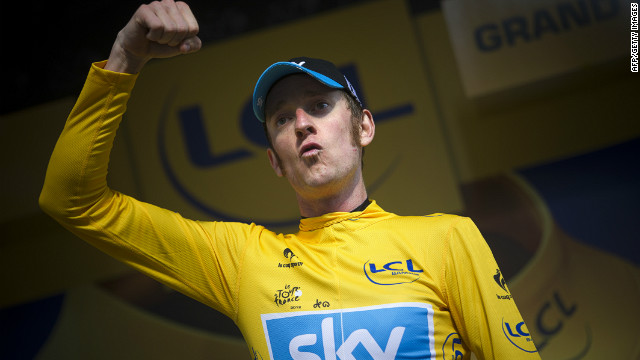 Bradley Wiggins celebrates after a dominant performance saw him take control of the Tour de France