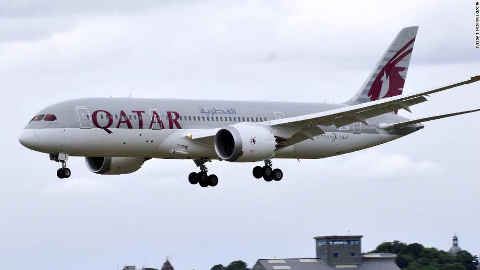 The 787 Dreamliner in Qatar colors comes in for a landing after a rare seven-minute display.