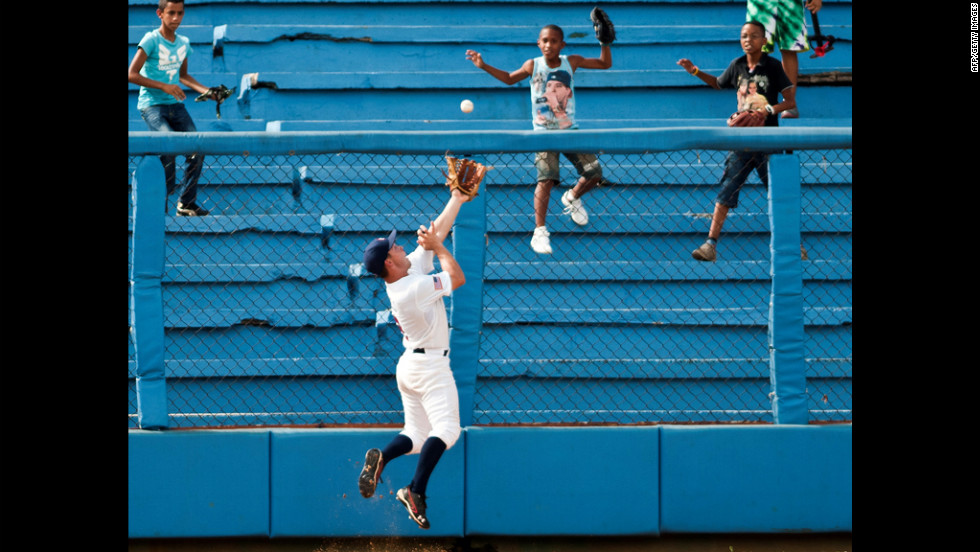 U.S. baseball player Johnny Field jumps to catch a ball Sunday during an exhibition game against Cuba in Havana.