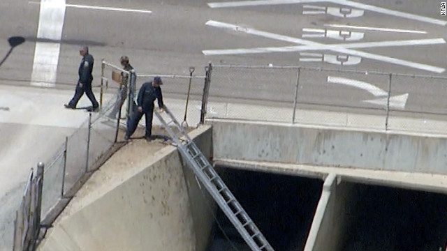 Orange County, California, officials respond to a suspicious backpack found under a bridge in Placentia on Monday.