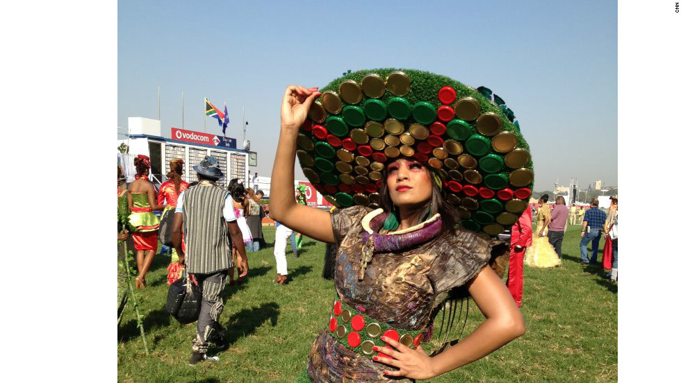 A competition entrant sports a hat made entirely from jar lids and other recycled materials.