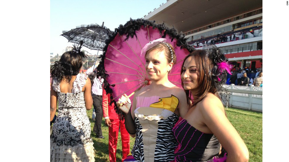 Ascot may uphold a strict policy regarding strapless dresses, but anything passes in the name of fashion at the Durban July Handicap.