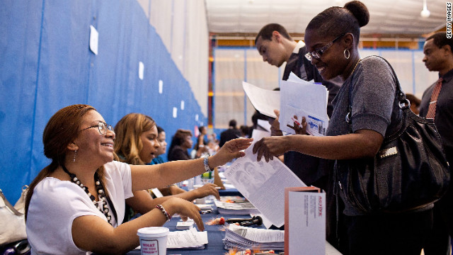 A woman speaks to a potential employer at a New York state jobs fair in the Harlem Armory in New York on June 7.