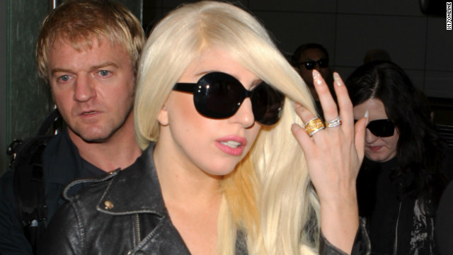 Lady Gaga flips off the crowd while wearing see thru leggings at LAX. July 9, 2012 X17online.com