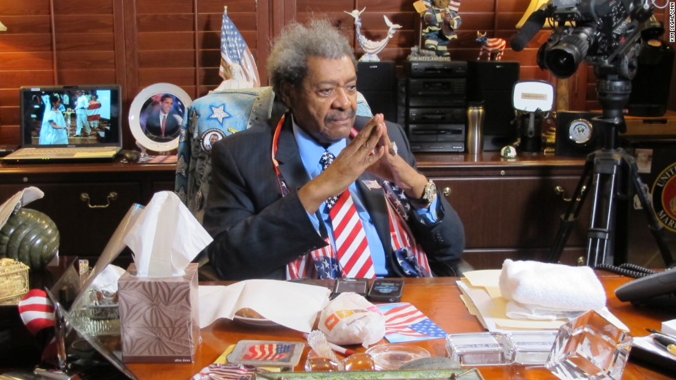 "Don King, 81, sits at his desk at his South Florida office, which is more like a museum than an office.  Known as a boxing promoter, King says he aspires to use the sport ""as a catalyst to bring people together."""