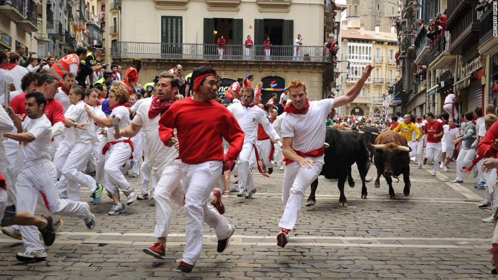 Participants run in front of El Pilar bulls on the fourth day of the San Fermin festival on Tuesday, July 10.