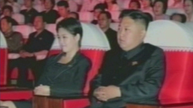 Mystery woman appears with Kim Jong Un