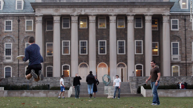 In the wake of the Jerry Sandusky scandal, Penn State University students play frisbee on campus in November.