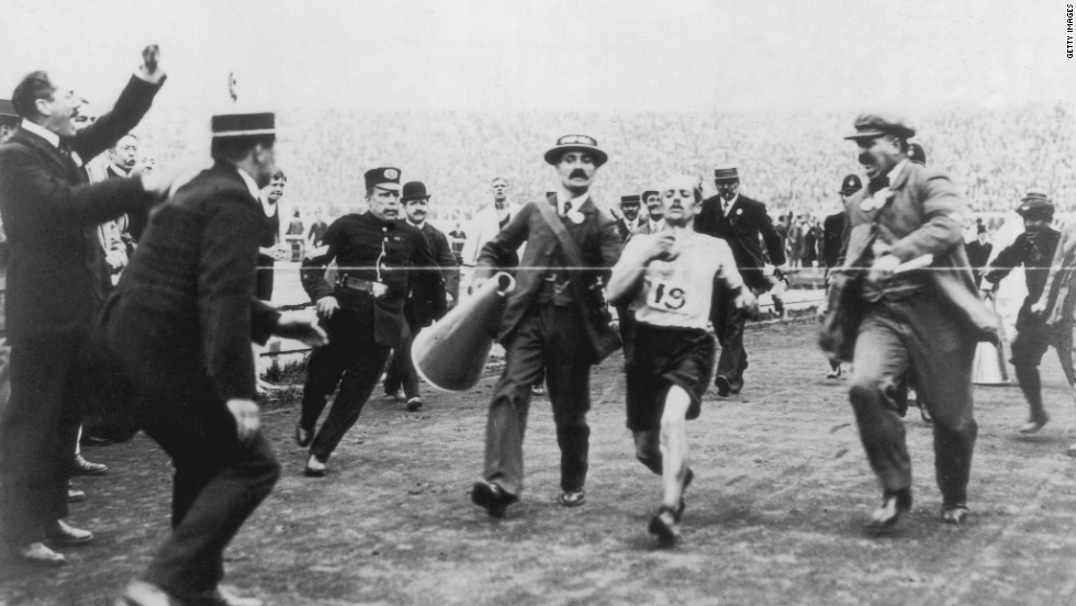 On the verge of collapse, marathon runner Dorando Pietri is helped across the finish line at the 1908 London Olympics. The Italian was subsequently disqualified and the title given to John Hayes of the U.S.