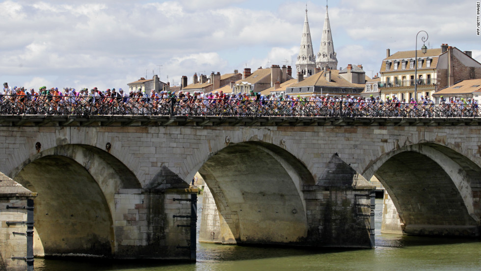 The cyclists cross a bridge in Macon at the beginning of Wednesday's events.