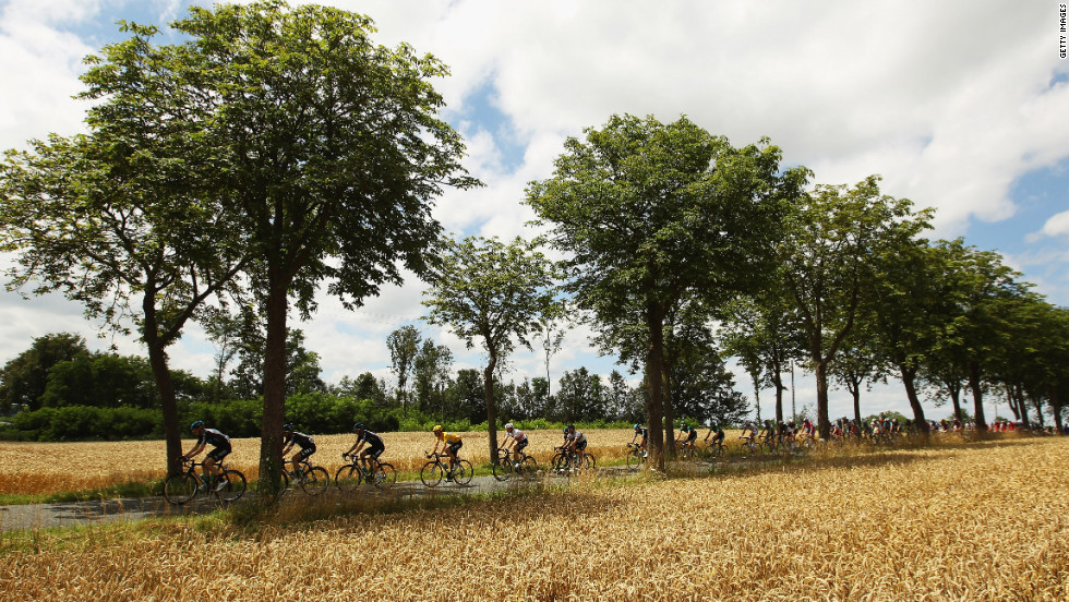 Race leader Bradley Wiggins of Great Britain rides through the French countryside in the main pack of riders Wednesday.
