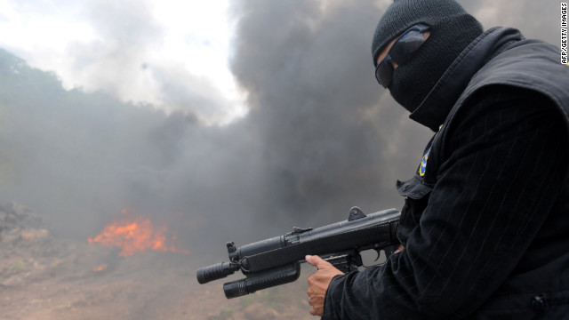 A policeman stands watch during the incineration of 456 kilos of cocaine on July 4 near Tegucigalpa, Honduras.