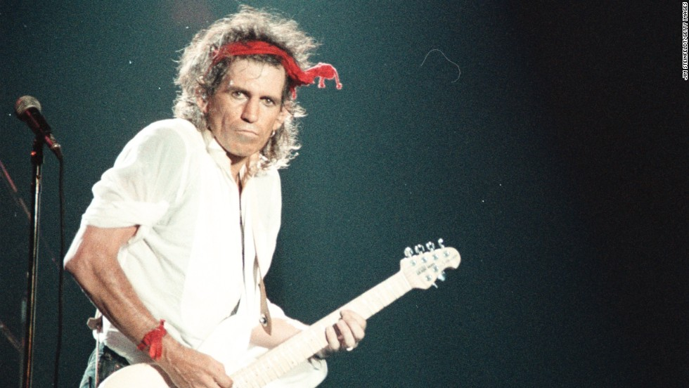 "Guitarist Keith Richards performs at the Aragone Ballroom in Chicago, Illinois, in 1987. The songwriter collaborated with Mick Jagger on their first international number 1 hit ""(I can't get no) Satisfaction"" in 1965."
